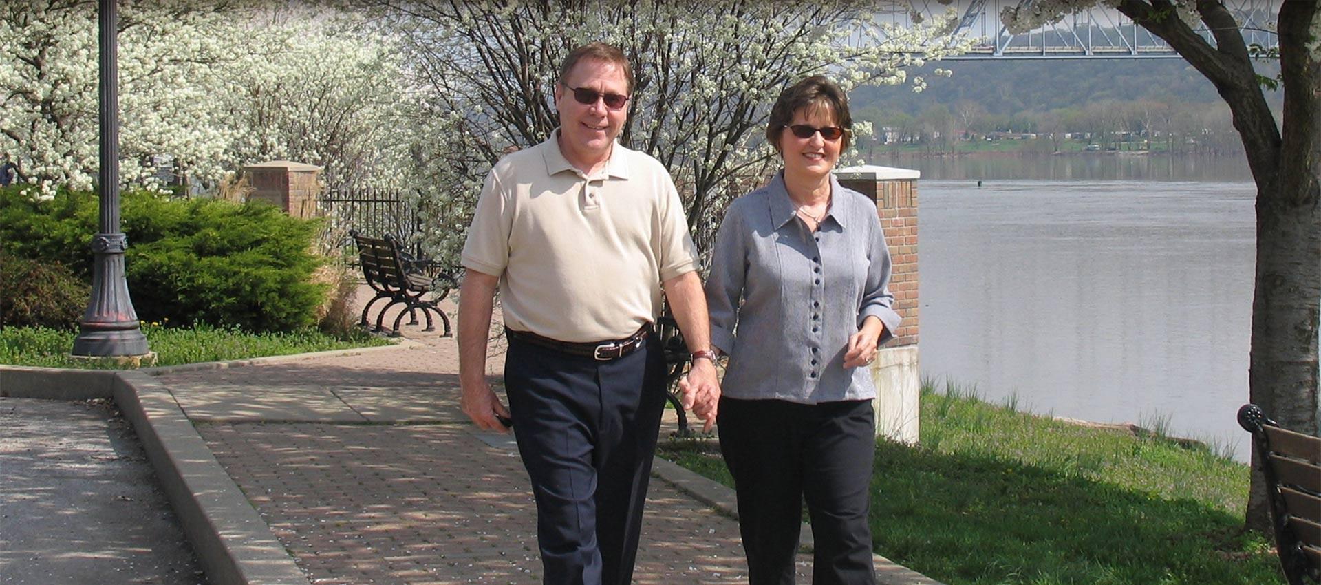 Couple Walking on Riverfront